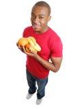 De Afrikaanse Amerikaanse vruchten van de mensenholding Stock Afbeeldingen