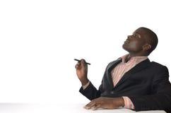 De Afrikaanse bedrijfsmens schrijft vrije exemplaarruimte Stock Afbeelding
