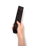 De afstandsbediening van de holdingsTV van de hand Stock Fotografie