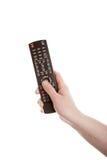 De afstandsbediening van de televisie in de hand royalty-vrije stock foto