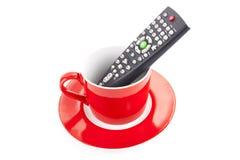 De afstandsbediening van TV in rode kop Royalty-vrije Stock Afbeeldingen