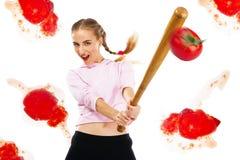 De afstraffing van de dame van tomaten met een honkbalknuppel stock fotografie