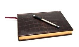 De agenda en de pen van het leer Stock Afbeeldingen