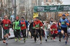 De agenten op traditionele Vilnius-Kerstmis rennen stock afbeelding