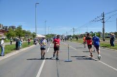 De agenten tijdens Marathon rennen Stock Afbeeldingen