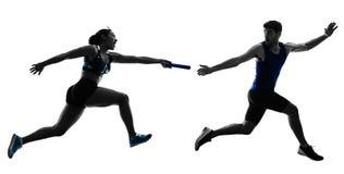 De agentensprinters die van het atletiekrelais agenten geïsoleerde silho in werking stellen stock foto