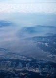 De Alpen en de hemel uit het vliegtuig Stock Foto's