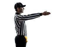 De Amerikaanse gebaren van de voetbalscheidsrechter eerst onderaan silhouet royalty-vrije stock afbeeldingen