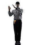De Amerikaanse opzettelijke gebaren van de voetbalscheidsrechter stock fotografie
