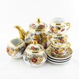 De antieke porseleinthee en coffe plaatste met bloemmotief Stock Afbeeldingen