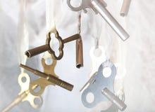 De Antieke Sleutel met twee uiteinden van de Klok Royalty-vrije Stock Foto