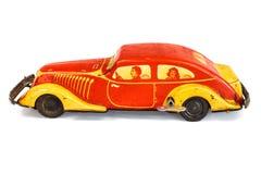 De antiquiteit beëindigt autostuk speelgoed met binnen familie stock afbeelding