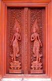 De antiquiteit sneed houten deur stock foto