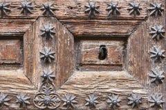 De antiquiteit verfraaide houten deursleutelgat Uitstekende achtergrond royalty-vrije stock fotografie