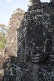 De antropomorfe gezichten sneden in steen in Bayon Wat, een de 12de eeuwtempel binnen Angkor complexe Thom royalty-vrije stock afbeeldingen
