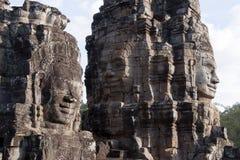 De antropomorfe gezichten sneden in steen in Bayon Wat in recente middaglicht, een de 12de eeuwtempel met royalty-vrije stock afbeeldingen