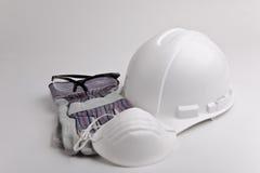 De apparatuur van de veiligheid de handschoen en het masker van bouwvakkerglazen Royalty-vrije Stock Foto's