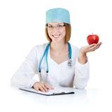 De appel een dag houdt weg de arts Stock Foto's