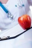De appel een dag houdt weg de arts Royalty-vrije Stock Foto's