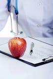 De appel een dag houdt weg de arts Stock Fotografie
