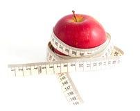De appel van de close-up met heerser Stock Fotografie