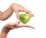 De appel van de hand in een hand Royalty-vrije Stock Afbeelding