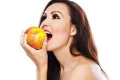 De appelbeten van de vrouw Stock Afbeelding