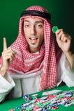De Arabische man die in het casino spelen Stock Foto