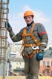De arbeider van de bouwer bij bouwwerf Royalty-vrije Stock Afbeeldingen