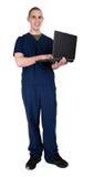De Arbeider van de gezondheidszorg met de Computer van het Notitieboekje Royalty-vrije Stock Afbeeldingen