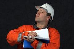 De arbeider van de mijn met dossier Stock Foto