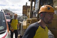 De arbeiders van de aardbevingshulp bij de Noodsituatiekamp van Rieti, Amatrice, Italië Royalty-vrije Stock Fotografie