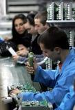 De Arbeiders van de diodefabriek Stock Foto