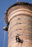 De Arbeiders van de schoorsteen Stock Afbeeldingen