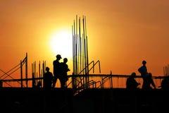 De arbeiders van het silhouet Stock Foto's