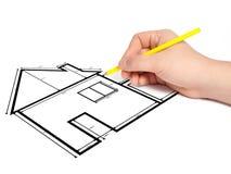 De architect trekt een project van het tekeningshuis Stock Afbeelding