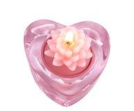 De aromatische bloem van de kaarslotusbloem in een candlestic glas royalty-vrije stock afbeeldingen