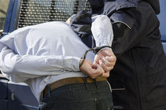 De arrestatie van een mens stock foto's
