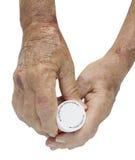 De artritisholding van de hand pil-knippende weg Stock Afbeeldingen