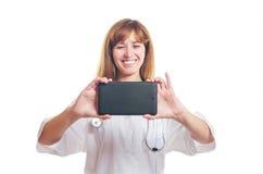 De arts fotografeert de tablet Stock Afbeeldingen