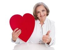 De arts met hart beduimelt omhoog Royalty-vrije Stock Afbeeldingen