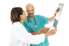 De artsen herzien de Resultaten van de Röntgenstraal Stock Fotografie