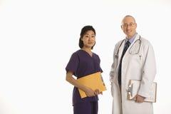 De artsen van de man en van de vrouw. stock afbeeldingen