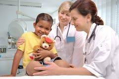 De artsen van kinderen Stock Foto's