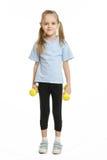 De atleet die van het zes éénjarigenmeisje zich met domoren bevinden Royalty-vrije Stock Foto's