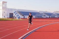 De atletenlooppas van de mens. Stock Foto's