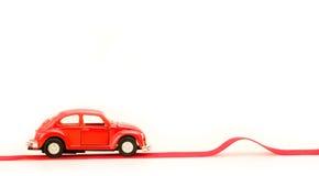 De auto en de buil van het stuk speelgoed Stock Afbeeldingen