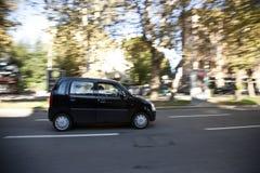 De auto van de stad op de weg Royalty-vrije Stock Afbeeldingen