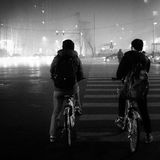 De autoriteiten van Peking voeren het smog waakzame oranje niveau op Stock Afbeelding