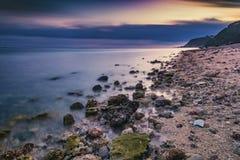 De avond op het strand stock foto's